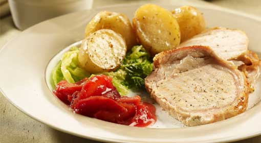 Roast pork loin with warm plum and ginger chutney